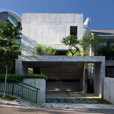 Carport and terrace above: Namly House, Singapore, by Chang Architects