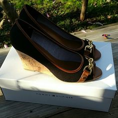 Tommy Hilfiger shoes.. New.. never been used..still in box..size 7.5...dark blue color..with a gold chain on the front saying Tommy Hilfiger.. Tommy Hilfiger Shoes Wedges
