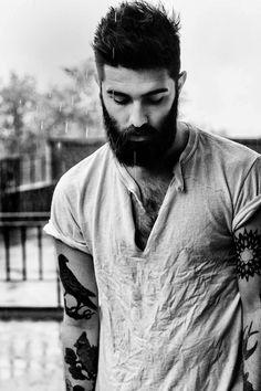 Bearded man with arm tattoos