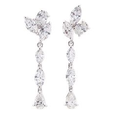 Part of their signature Wedding collection, these earrings from Anyallerie feature assorted cuts beautifully arranged in a mismatched style. Swinging with a de…