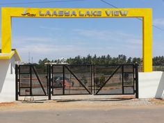 Laasya Lake View Plots in Basapura Begur Road Bangalore, LAASYA Lakeview is indeed the most phenomenal project with its connectivity to the IT Hub,. House Main Gates Design, Fence Gate Design, Entrance Design, Entrance Gates, Gated Community, Apartments For Sale, Lake View, Street, Building