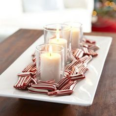 So simple- peppermint candies w/glass votives on white dish