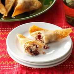 Thanksgiving Wontons Recipe -We get creative with leftovers and make them into wontons. With a little turkey, cream cheese, cranberry sauce and wrappers, you've got appetizers. —Sarah Gilbert, Beaverton, Oregon
