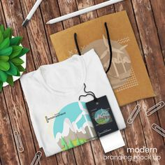 Download T Shirt Logo Mockup And Shopping Bag Mockup On Rustic Wooden Table With Sales Tag And Decor Psd Mock Up Logo Mockup Bag Mockup Modern Business Cards