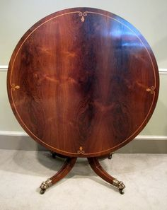 Regency Rosewood Circular Centre Table-A fine Regency period rosewood circular tilt top centre table, with boxwood inlayed decoration on a turned column, hipped four splay base and wonderful original leaf cuffed brass claw castors. Circa 1825.