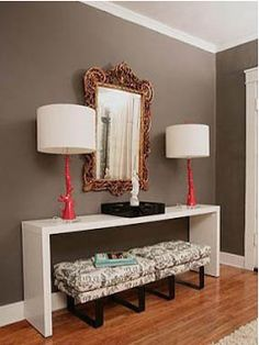 Brownish gray color for living room kitchen and dining room with an accent wall painted a deep red in the dining room
