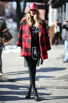 Gorgeous textured skirt, tartan topper, leather cap, and a Chanel bag...How can you top such a look. #NYFW