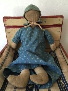 "Early Primitive Antique Cloth Rag Doll. She is all hand sewn and hard stuffed with rags and cotton . She shows age and wear and has some staining to her body. Please study pictures and ask questions. This doll was certainly well loved and is in played with condition. Her dress and bonnet are the most beautiful early calico and original to her and are hand and machine sewn. She's a wonderful early antique cloth rag doll. The doll displays wonderfully on her own or in a collection. The doll measures 14"" tall. Condition of this item: Shows age and wear, age stains , fading, holes, rips, .  Sold Ebay  525.00"