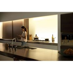 Bring brilliantly colored light to any area of your home with the flexible Lightstrip. Unlike other strip lighting options, the Lightstrip can be paired with a Hue Bridge to offer a full suite of smart lighting control and features. Subtle Background, Lights Background, Phillips Hue Lighting, Philips Hue, Home Network, Home Gadgets, Strip Lighting, White Light, Light Colors
