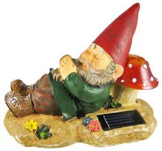 """Sleeping Garden Gnome Solar Powered Accent Light by Private Label. $19.95. Actual Dimension: 8.66""""x4.33""""x6.69"""" (LxWxH). Battery: AA 1.2V 2 Rechargeable Ni-Cad battery. Material: ABS/PS, Poly resin. Light color: White LED. Solar power: Crystalline solar cell. This wonderfully detailed sleeping garden gnome outdoor garden or porch statue has a solar powered LED light inside the mushroom the gnome is resting his head on. The light turns on automatically in dark conditions, and l..."""