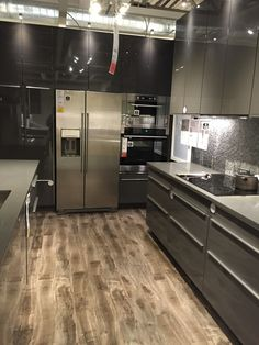 IKEA cabinets. Sektion with Ringhult fronts in shiny grey. Also wood tone floor.