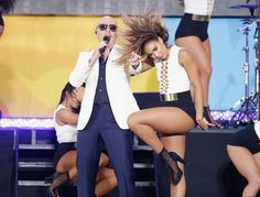 Pin for Later: 12 Celebrity Couples You'll Want to Channel This Halloween — Trust Us! Pitbull and a Sexy Backup Dancer