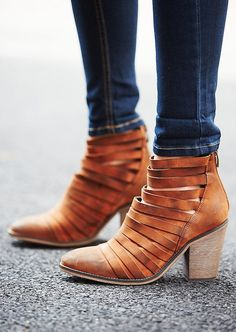 Brown leather ankle boots with texture.