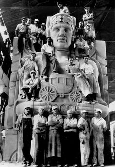 Cleveland: Stone carvers pose on a pylon of the Lorain-Carnegie Bridge, later renamed the Hope Memorial Bridge, ca. 1931.