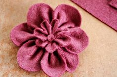 Idea for 2-layer blossom. Make 2 individual fabric flowers, sew or glue the smaller bloom onto the bigger one and add a pretty button, bling or pear in the centre. :)