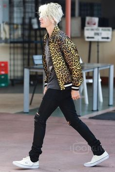 Justin Bieber wearing  Saint Laurent Leopard Printed Viscose Teddy Jacket, Fear of God Slayer Resurrected Vintage Tee, En Noir EN-001 Jean in Coated Cash Denim