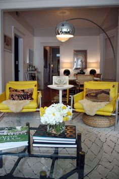 love the quick burst of yellow in an otherwise neutral space. also the lamp!