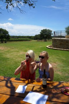 The Fortuitous Foodies sisters enjoying a glass of red at Perissos Vineyards on a gorgeous summer day in Texas.