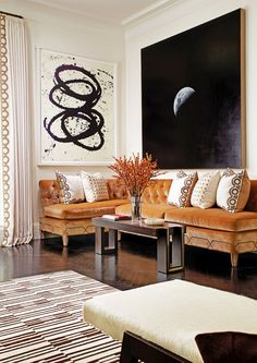 Brown and white striped rug in New York living room designed by Christina Murphy…