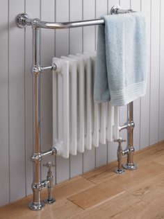 A traditional heated towel rail cleverly integrating a cast iron radiator.  All our St James heated towel rails are dual fuel with a 300w heating element for when your heating is turned off.