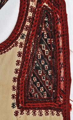 Detail of an embroidered 'sayias' (bridal and festive, summer, cotton, sleeveless overcoat), from Grevena (Macedonia, Northern Greece), ca. late 19th century. Close-up of the decoration at the chest: applique loutres and the embroidered tsapari.
