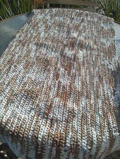 Check out this instructional video, or amend those instructions and make a plastic bag rug. If you decide to crochet a mat to gift to a shelter, ask your local shelters to see if they'd be interested in accepting it.(Photo: 1 Million Women)