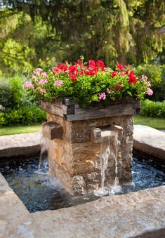 Flowers and water...Flowers on top...Fountain flowers!...flower fountain""