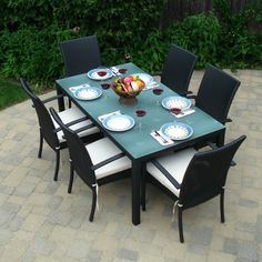 Fabulous Patio Furniture Dining Set With Black And White Armchairs Design Also Trendy Glass Top Table Idea