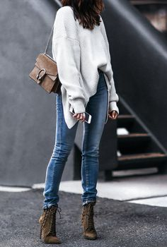 slouchy oversized sweater, skinny jeans, and lace up booties Sweater: Chicwish also available in Tan Jeans: Saint Laurent (Similar) Shoes: Oscar Tiye also available in Black Bag: Gucci Choker: Rendor and Steel