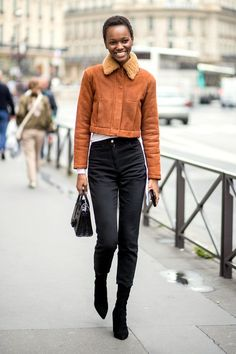 A cropped brown jacket meets its perfect match in your go-to high-waisted black skinny jeans.