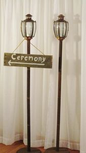 rustic lamp posts with optional sign.  Uniquely Yours Wedding Design