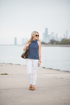 Chicago blogger Bows & Sequins styling a Sail to Sable navy striped top with Old Navy jeans, a Louis Vuitton tote, Celine aviators, and Dune London leather mules.