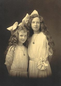 ~+~+~ Antique Photograph ~+~+~  Sweet Sisters both with long hair and big bows.