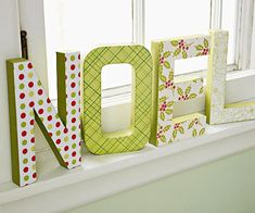 Big NOEL letters on sill These decorated letters are a great handmade project. Choose an assortment of decorative holiday papers. Then, using wood letters from a crafts store trace a front for each letter onto the blank side of your patterned papers. Cut out the shapes and glue the paper pieces to their corresponding letters. Prop on a windowsill or a mantel for cheerful and easy holiday display.