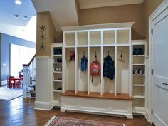 Umm....I love this mud area and would LOVE to have this in my mud room. White open cubbies I dream of YOU!
