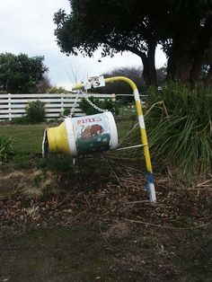 A very nicely painted old milk can is a popular item to be use for mail boxes.