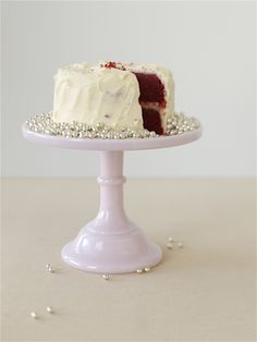 A sweet layer red velvet cake on a layer of pearl dragees, resting on a pale pink milk glass pedestal. Looks amazing! From BHLDN. Wedding Desserts, Wedding Cakes, Wedding Decorations, Dessert Stand, Dessert Tables, Cake Accessories, Cake Plates, Pretty Cakes, Cakes And More