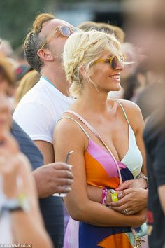 The look of love: The couple could barely keep their hands off one another as they watched Tom Petty and Stevie Nicks perform in Hyde Park