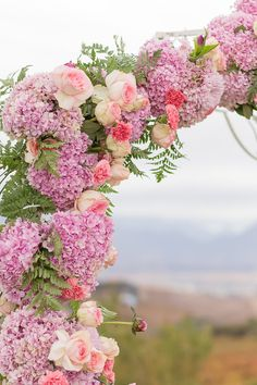 Romantic floral arch made of pink hydrangea, blush roses, ferns and carnations. This gorgeous blush and navy wedding at Landtscap is filled with cute details and ideas! Photos: Adele Kloppers Photography Click to see more: http://www.confettidaydreams.com/landtscap-wedding/