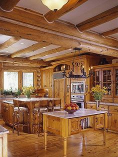 Exposed beams and heavy-wood accents give this Telluride, CO kitchen an old world feel.