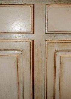 Glazing the kitchen cabinets.