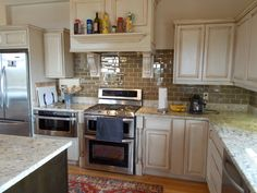 Antique Kitchen Island Ideas With Trendy Antique White Cabinets As Kitchen Cabinetry Set With Shelves And Cool White Marble Countertop And Brown Glass Tile Like Brick Backsplash And Single White Marble Kitchen