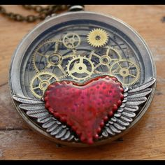 Altered art winged Pocket watch. Gears visible and winged heart.