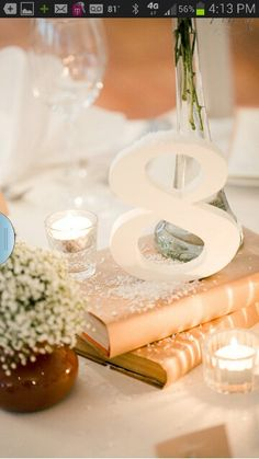 Gold books, snow, and wooden numbers for creative centerpieces