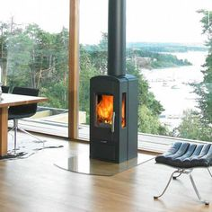 I want a wood burning stove in front of my picture window when I build my house in the garden.
