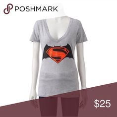 Comic batman vs superman justice shield Product Details Proudly sport your favorite superheroes with this juniors' Batman v Superman: Dawn Of Justice graphic tee.  PRODUCT FEATURES Batman v Superman: Dawn of Justice shield V-neck Short sleeves Tag free FABRIC & CARE Machine wash 3.26 Tops
