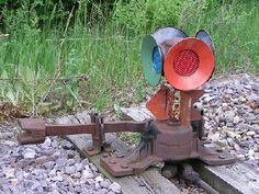 A switch lamp was mounted to a track switch and would indicate (using specific colors) which position the switch was set to.  Usually a green signal indicated the switch was set to straight ahead while a red signal indicated that the switch was set to the turn out.