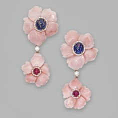 PAIR OF 18 KARAT PINK GOLD, CARVED CORAL, RUBY, SAPPHIRE AND DIAMOND PENDANT-EARCLIPS, MICHELE DELLA VALLE Designed as flowerheads set in the center with cabochon sapphires and rubies, accented by small round diamonds weighing approximately .80 carat, the petals composed of carved coral, with retractable posts, signed Michele della Valle, numbered 110754.