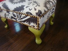 DIY footstool makeover. nailhead trim. check out the before and after on my blog:  www.thehoundstoothandnail.com