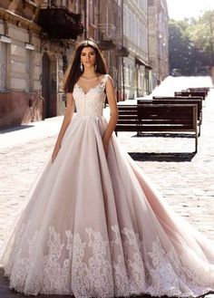 sleeveless blush ballgown with embroidered hem via tm crystal design / http://www.himisspuff.com/top-100-wedding-dresses-2017-from-top-designers/8/